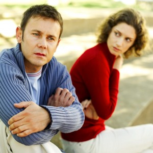 Woman Looking at a Man Sitting Beside Her --- Image by © Royalty-Free/Corbis